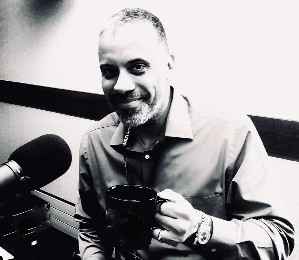 Larry Sharpe drinking coffee